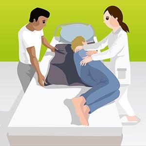 Umlagerung mit Hilfe einer Gleitmatte durch 2Pflegekräfte_Bild4
