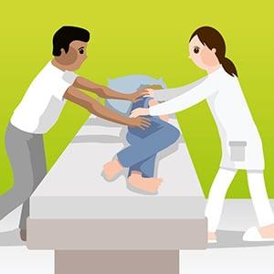 Umlagerung-des-Bewohners-mit-zwei-Pflegekräften_BiglaCare